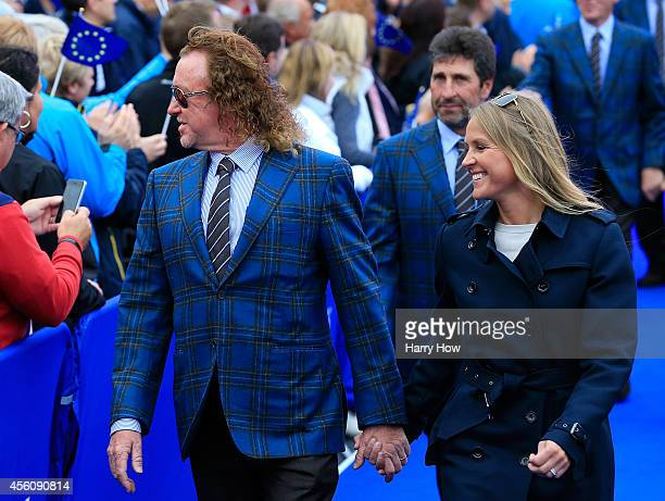 Europe team vice captain Miguel Angel Jimenez and wife Susanne Jimenez walk towards the stage during the Opening Ceremony ahead of the 40th Ryder Cup...