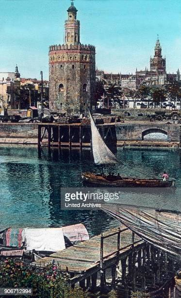 Europe travel Spain Andalusia Seville Golden Tower Torre del Oro image date 1910s 1920s Carl Simon Archive history historical city river Guadalquivir...