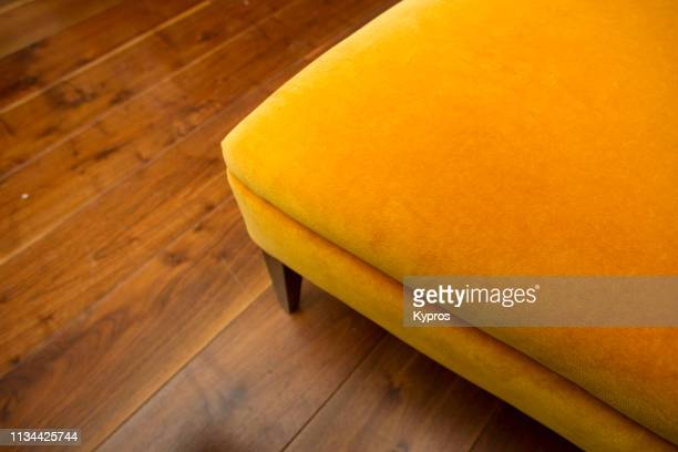 europe, uk, england, london, belgravia: view of hand-made custom fabric couch with african hardwood flooring - terciopelo fotografías e imágenes de stock