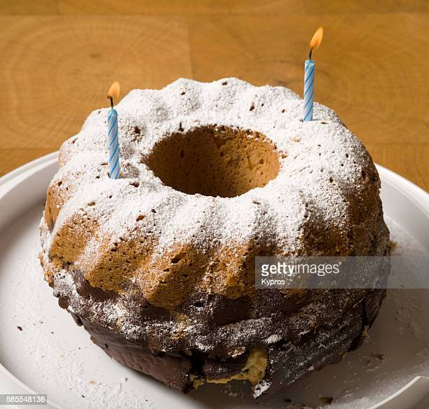 Europe, Uk, England, London, View Of Birthday Cake With Two Candles Burning