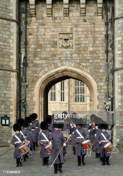 europe, uk, england, windsor, windsor castle (circa 2004): view of military band wearing bearskin hats. - animal skin rug stock photos and pictures