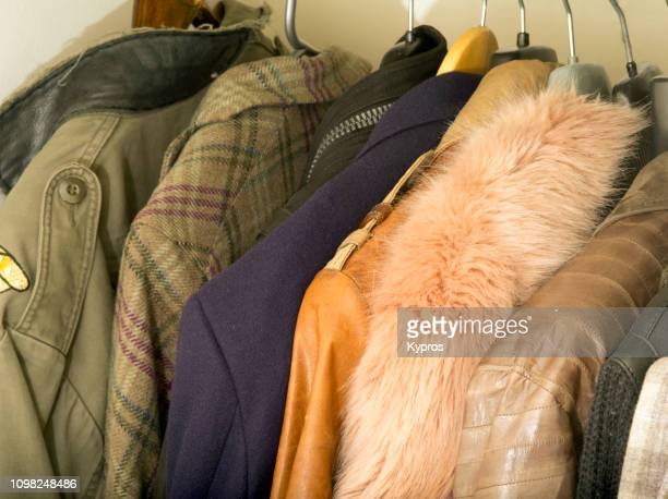 europe, uk, london, 2018: view of expensive mens jackets hanging in clothes cupboard, within private home - fur jacket stock pictures, royalty-free photos & images