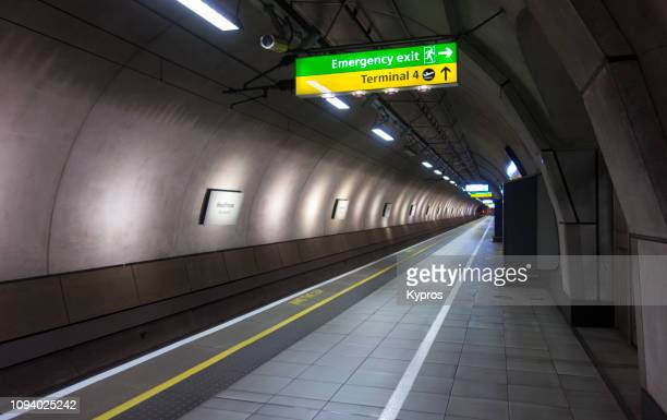 europe, uk, london, 2018: view of underground or subway train station - heathrow terminal 4 - heathrow stock pictures, royalty-free photos & images