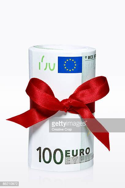 European 100 Euro notes tied with ribbon