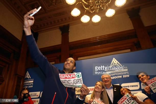 European 110m hurdles champion Pascal MartinotLagarde of France takes a selfie at a press conference ahead of the 2019 European Athletics Indoor...