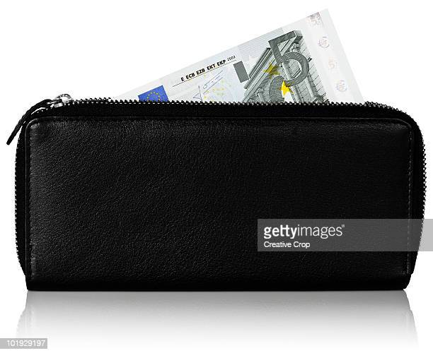 european 5 euro note in black leather purse - five euro banknote stock photos and pictures