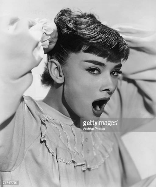 European actress Audrey Hepburn stars in the romantic comedy 'Roman Holiday' 1953 She plays a young princess who must choose between her duty to her...