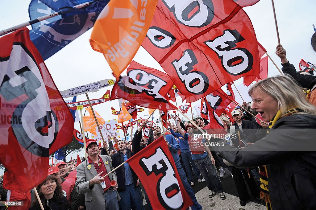 European aircraft manufacturer Airbus employees demonstrate on April 23, 2010 in Toulouse, southwestern France, in front of the entrance of their company to ask for better rise of their wage.