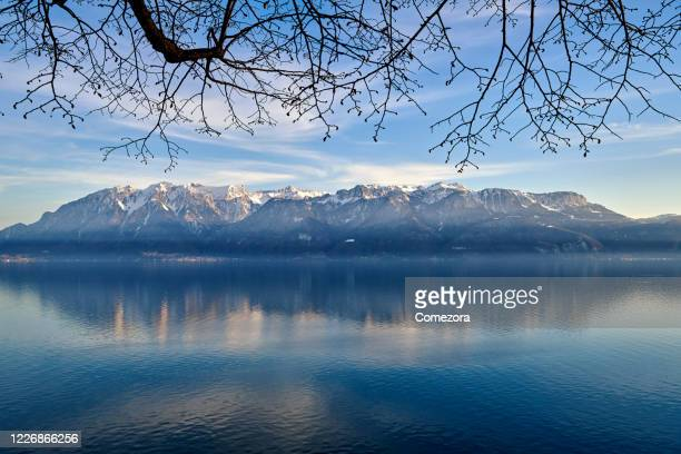 european alps at lake geneva in sunset sunlight - montreux stock pictures, royalty-free photos & images