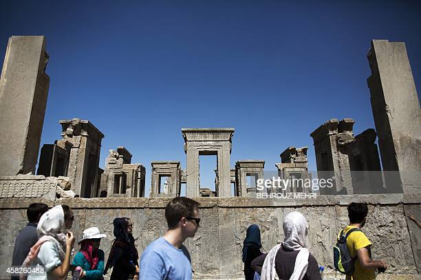 European and Iranian tourists visit the Tachara Palace also known as the palace of King Darius of Achaemenid at the ancient Persian city of...