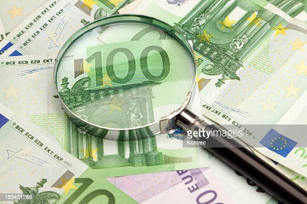 European banknotes (Euro currency) through a magnifying glass