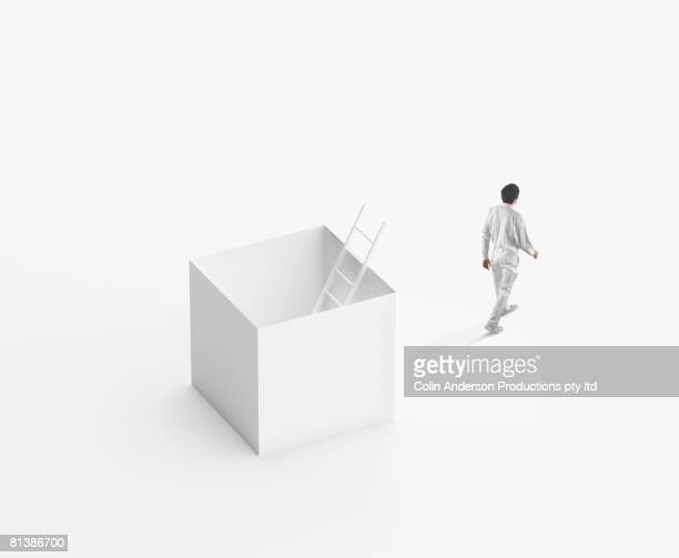 European businessman walking away from box