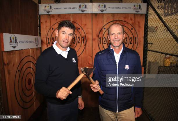 European Captain Padraig Harrington and United States Captain Steve Stricker pose together after an axe throwing competition during the Ryder Cup...