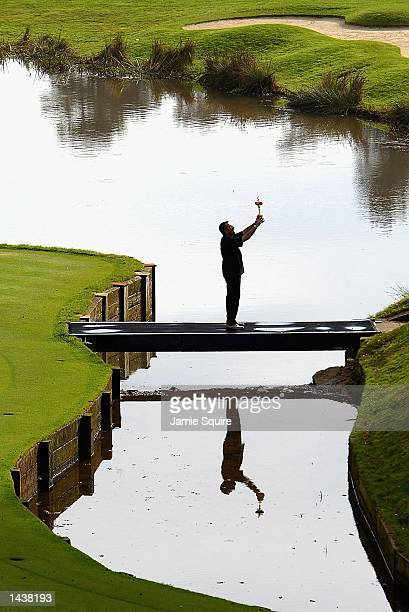 European Captain Sam Torrance of Scotland hoists the Ryder Cup after Europe defeated the United States in the 34th Ryder Cup at the De Vere Belfry in...