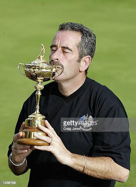 European Captain Sam Torrance of Scotland with the Ryder Cup after Europe defeated the United States in the 34th Ryder Cup at the De Vere Belfry in...
