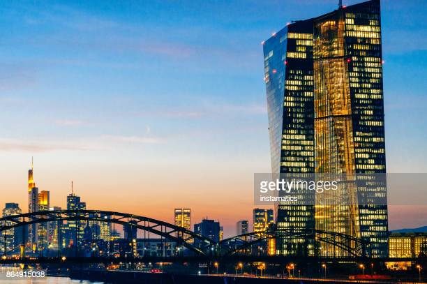 european central bank building after sunset - european central bank stock photos and pictures
