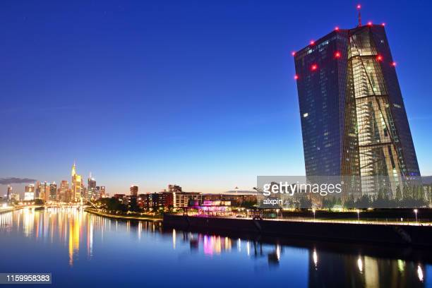 european central bank building in frankfurt - twilight stock pictures, royalty-free photos & images