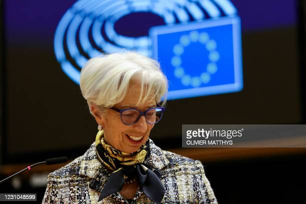 European Central Bank President Christine Lagarde smiles as she addresses European lawmakers during a plenary session at the European Parliament in...
