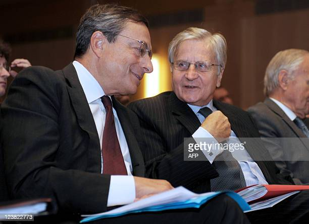 European Central Bank president Jean Claude Trichet listens to Bank of Italy Governor and Incoming European Central Bank president Mario Draghi as...
