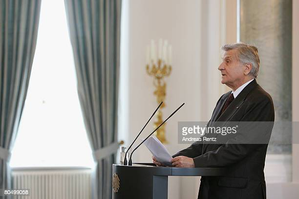 European Central Bank President JeanClaude Trichet speaks after receiving the Federal Cross of Merit from German President Horst Koehler at Bellevue...