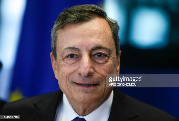 European Central Bank President Mario Draghi arrives to deliver a speech during a meeting of the Committee on economic and monetary affairs at the...