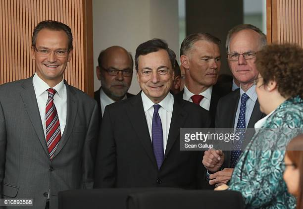 European Central Bank President Mario Draghi arrives with Bundestag Europe Commission Chairman Gunther Krichbaum and Bundestag President Norbert...