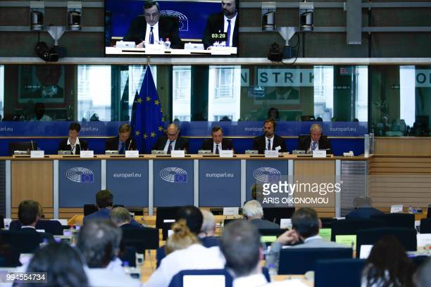 European Central Bank President Mario Draghi delivers a speech during a meeting of the Committee on economic and monetary affairs at the European...