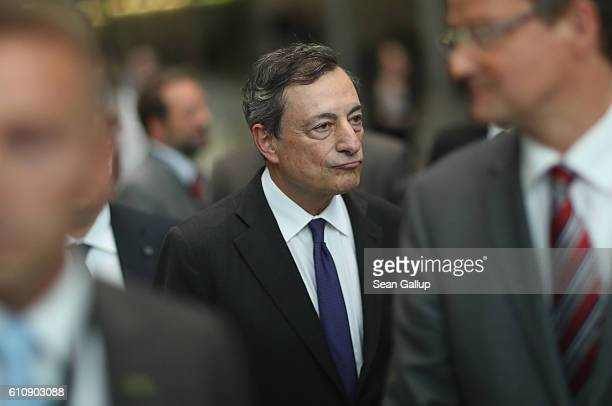 European Central Bank President Mario Draghi departs after speaking to the media after he attended a session of the Bundestag Europe Commission on...