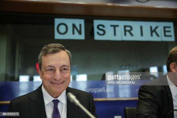 European Central Bank President Mario Draghi looks on before delivering speech during a meeting of the Committee on economic and monetary affairs in...