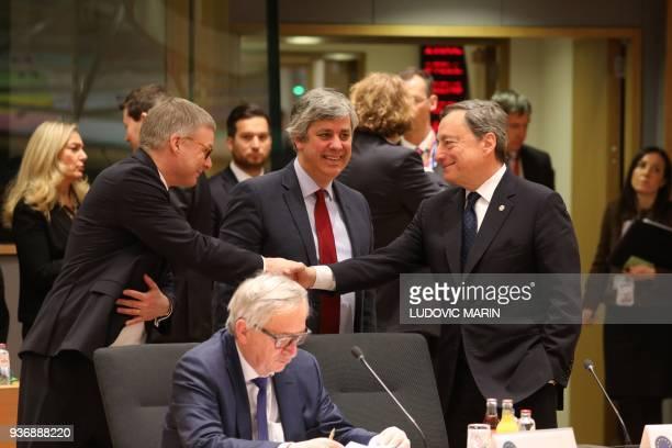 European Central Bank President Mario Draghi next to President of the Eurogroup Mario Centeno and European Commission President JeanClaude Juncker...