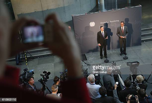 European Central Bank President Mario Draghi speaks to the media after he attended a session of the Bundestag Europe Commission on September 28 2016...