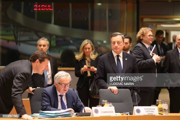 European Central Bank President Mario Draghi stands next to European Commission President JeanClaude Juncker flanked by newly appointed Secretary...