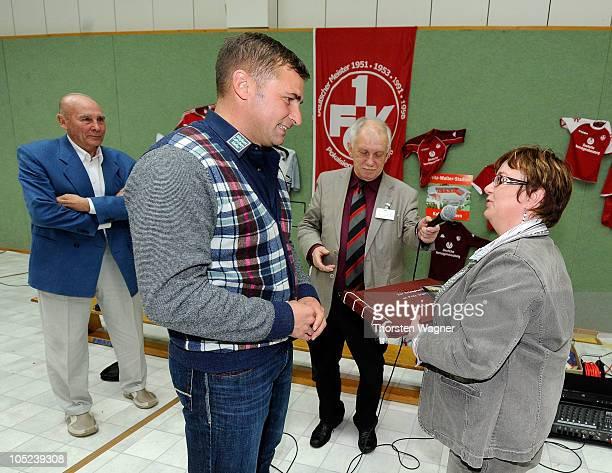 European champion Stefan Kuntz gets a present during a visit of Sepp Herberger Foundation at a prison on October 13 2010 in Zweibruecken Germany...