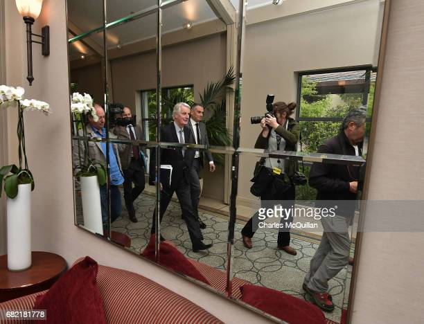European Commission Brexit chief negotiator Michel Barnier surrounded by media is reflected in a mirror as he arrives for the EPP Group Bureau...