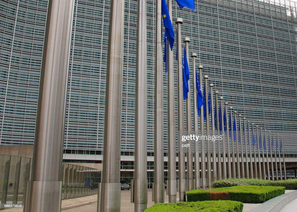 European Commission building in Brussels, Belgium an EU flag : Stock Photo