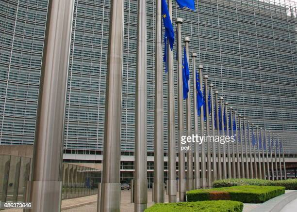European Commission building in Brussels, Belgium an EU flag