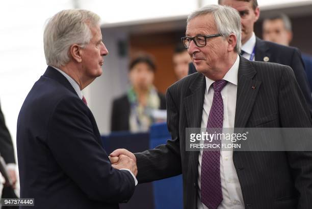 European Commission chief JeanClaude Juncker greets EU chief negotiator Michel Barnier during a meeting at the European Parliament on April 17 2018...