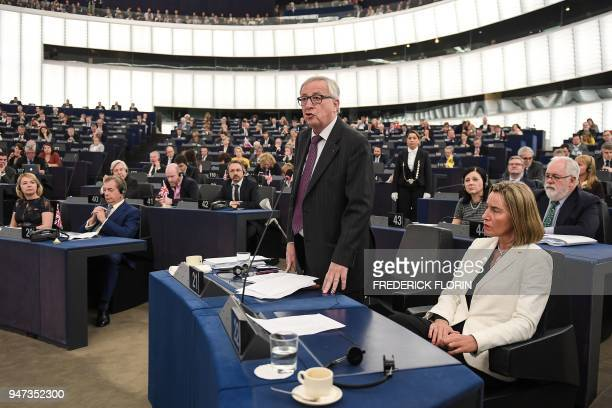 European Commission chief JeanClaude Juncker speaks next to EU diplomatic chief Federica Mogherini after French President's speech at the European...