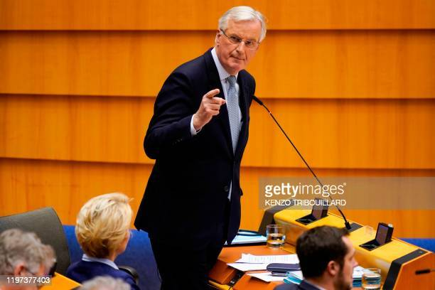 European Commission Chief Negociator Michel Barnier delivers a speech during a European Parliament plenary session in Brussels on January 29 as...