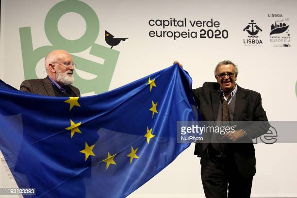 European commission executive vicepresident Frans Timmermans receives an EU flag made from recycled material from City Councilor of Lisbon Jose Sa...