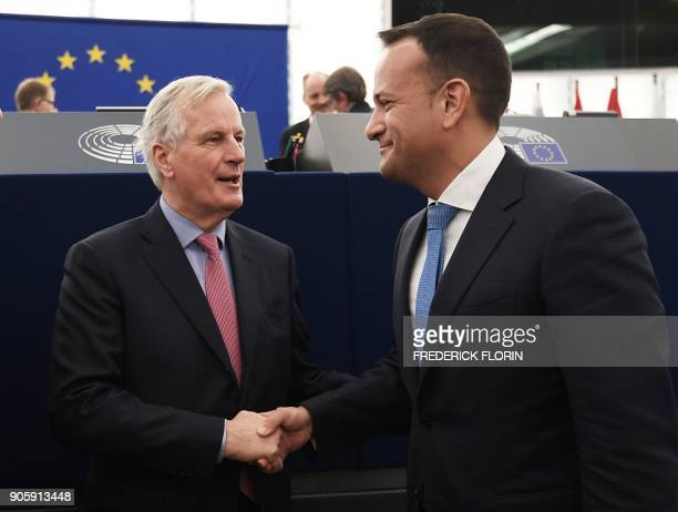 European commission member in charge of Brexit negotiations with Britain Michel Barnier shakes hands with Irish Prime minister Leo Varadkar prior to...