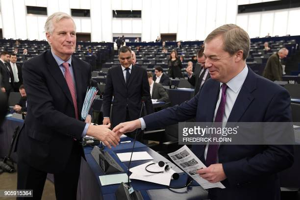 European commission member in charge of Brexit negotiations with Britain Michel Barnier shakes hands with European MP and former leader of the antiEU...