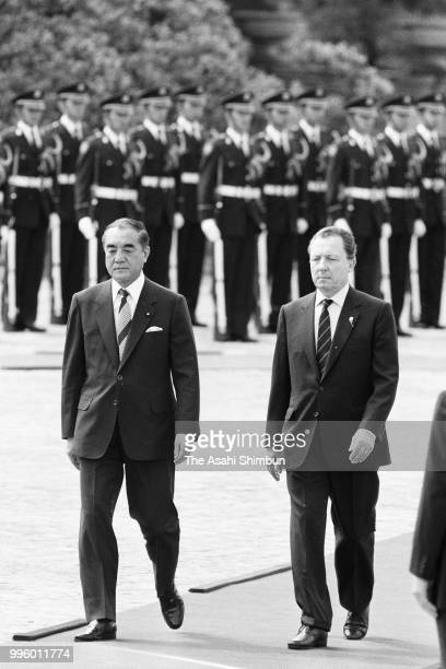 European Commission President Jacques Delors reviews the honour guard with Japanese Prime Minister Yasuhiro Nakasone during the welcome ceremony...