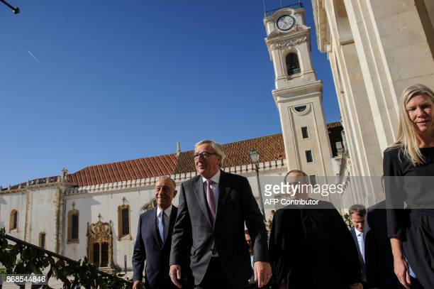 European Commission president Jean Claude Juncker is escorted by Portuguese President Marcelo Rebelo de Sousa and Coimbra University dean Joao...