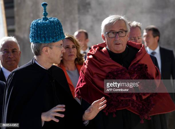 European Commission president Jean Claude Juncker listens to Coimbra University dean Joao Gabriel Silva on the sidelines of a ceremony during which...
