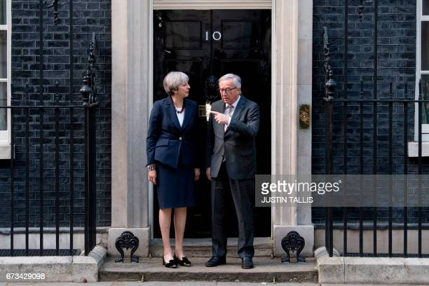 European Commission President JeanClaude Juncker and British Prime Minister Theresa May pose for a photograph outside 10 Downing Street in London on...