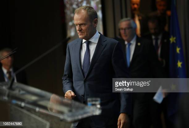 European Commission President Jean-Claude Juncker and European Council President Donald Tusk arrive to speak to the media following the October EU...