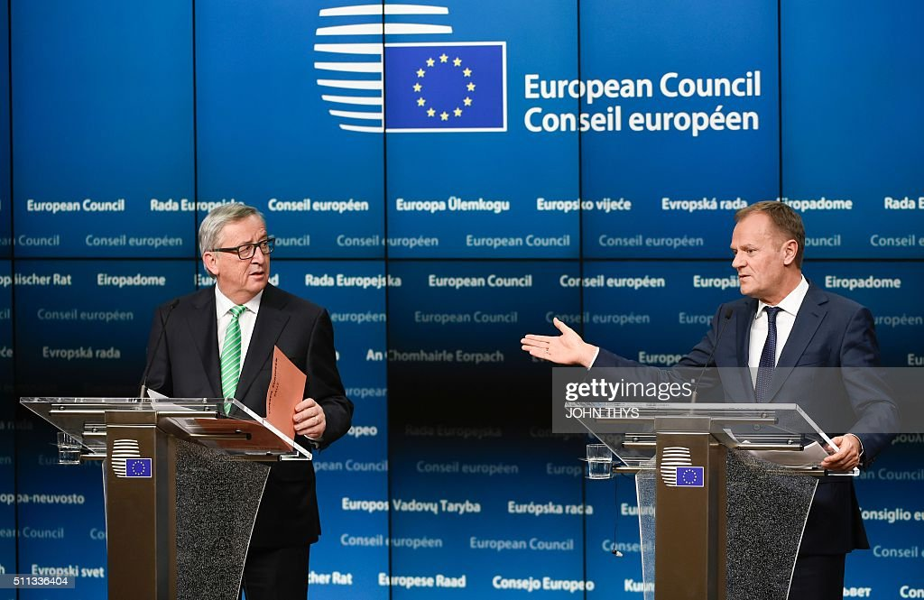 European Commission President Jean-Claude Juncker (L) and President of Council Donald Tusk give a joint press during an European Summit at the EU Headquarters in Brussels on February 20, 2016. The deal, sealed after hours of haggling at a marathon summit, paves the way for a referendum on whether Britain will stay in the EU. The European Union's two top figures, Donald Tusk and Jean-Claude Juncker, presented its 28 leaders with draft proposals at a long-delayed dinner after hours of painstaking face-to-face talks on an issue that threatened place in the union. / AFP / JOHN