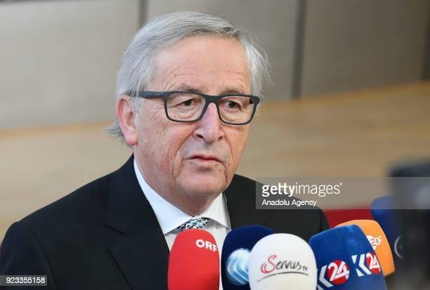 European Commission President JeanClaude Juncker answers the questions of press members as he arrives to attend the EU members' informal meeting of...