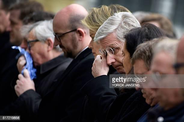 European Commission President Jean-Claude Juncker, Belgian Prime Minister Charles Michel and King Philippe - Filip of Belgium react before observing...